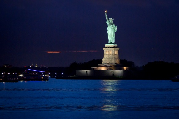 The Statue of Liberty is pictured from the Staten Island Ferry at twilight in New York